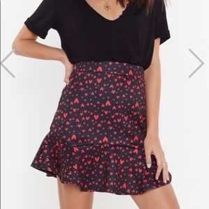 Black flirty skirt with Hearts on it